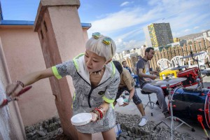 "During a live performance of the rock band Mohanik, interior designer Enerel, 26, paints on a wall of the Glamour art gallery in downtown UB. In 2013, Enerel who used to live and study for 10 years in the US decided it was time to return to Mongolia. ""More and more people are coming back"" she said ""bringing back what they learned abroad""."