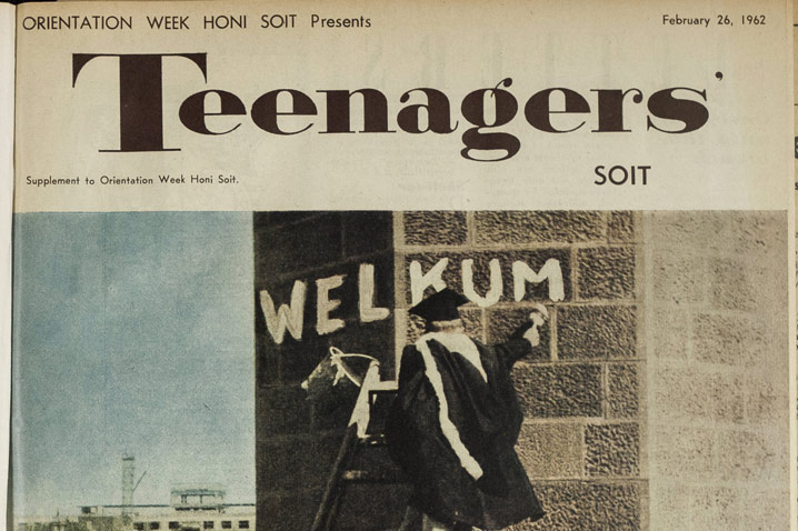 Part of the cover showing a scolar in graduation gown and hat painting the word Welkum on a building