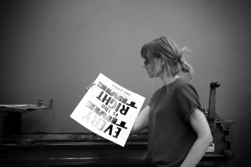 wendy murray printer in residence holds letterpress poster