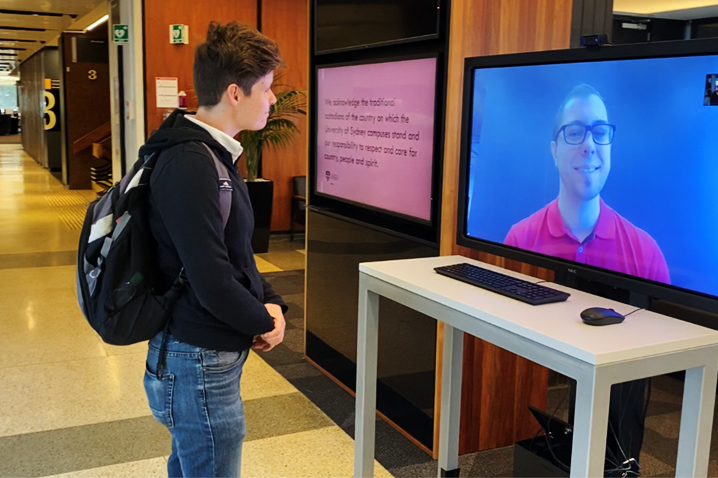 student speaking with virtual information desk staff